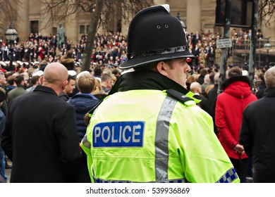LIVERPOOL UK, 13th NOVEMBER 2016. Police officer preparing for crowd control at the Remembrance Day Parade in Liverpool City Centre.