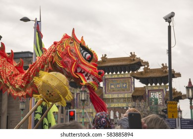 LIVERPOOL, UK, 2017. Street parade to mark Chinese New Year, the year of the rooster in Liverpool. Dragon dancers entertaining the crowd.  Editorial