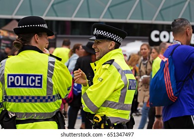 LIVERPOOL UK, 28th May 2017. Male and female British Police officers chatting whilst on crowd control duty