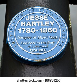 LIVERPOOL, UK - APRIL 17TH 2014: A blue plaque by the Institution of Civil Engineers at the Albert Dock in Liverpool, dedicated to Jesse Hartley who designed the Albert Dock on 17th April 2014.