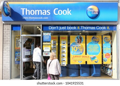 LIVERPOOL, UK - APRIL 20, 2013: People visit Thomas Cook travel agency in Liverpool, UK. Thomas Cook Group is a global vacation company with 22,672 employees (2014).