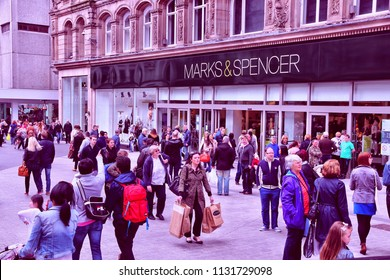 LIVERPOOL, UK - APRIL 20, 2013: People visit Marks & Spencer in Liverpool, UK. M&S is a major retailer with 1,010 stores in 41 countries. It specializes in fashion and luxury goods.