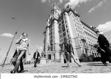 LIVERPOOL, UK - APRIL 20: People visit Pier Head area on April 20, 2013 in Liverpool, UK. Pier Head is part of Liverpool's famous UNESCO World Heritage Site.