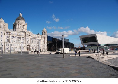 Liverpool, UK - April 3, 2015: buildings and people on developed waterfront of Liverpool, UK. The modern Museum of Liverpool was opened in 2011.