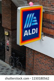 Liverpool, UK: Aug 3, 2018: Sign for an Aldi store in central Liverpool. The sign is seen from above. The sign features the Aldi logo which was updated in 2017
