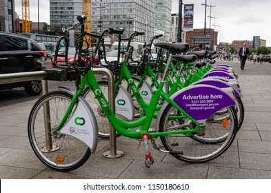 Liverpool, UK: Aug 3, 2018: Bicycles wait to be hired on The Strand, Liverpool. The City Bike scheme offers pay as you go cycle hire in Liverpool, England.