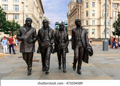 LIVERPOOL, UK - AUGUST 18, 2016:  Bronze statue of the four Liverpool Beatles stands on Liverpool Waterfront by sculptor Andrew Edwards.