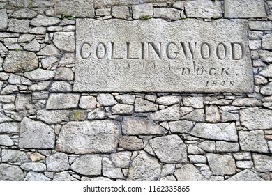 """LIVERPOOL, UK - AUGUST 7, 2015: Old stone wall with the inscription """"Collingwood Dock 1848"""" in Liverpool"""