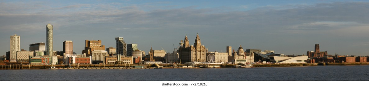 Liverpool, UK - December 1, 2017: Liverpool's UNESCO listed waterfront including modern office buildings, the Three Graces, the new Museum of Liverpool, the Anglican Cathedral and historic warehouses.