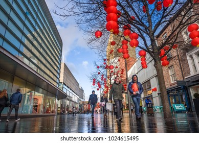 LIVERPOOL, UK - FEBRUARY  11, 2018: Lanterns hanging from trees in Liverpool One shopping precinct to celebrate the Chinese new year. Liverpool has the first  Chinatwon established in Europe.