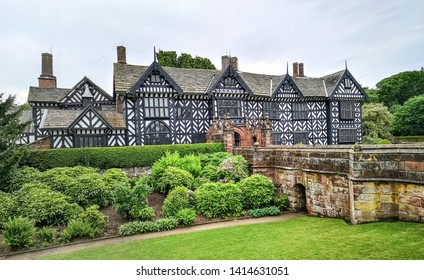 LIVERPOOL, UK - JUNE 01, 2019: View of Speke Hall which is a black and white wood-framed wattle-and-daub Tudor manor house in Speke, Liverpool, England.