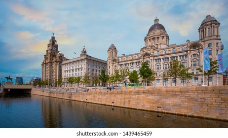Liverpool, UK - May 17 2018: Liverpool Pier Head with the Royal Liver Building, Cunard Building and Port of Liverpool Building part of the Liverpool Maritime Mercantile City UNESCO World Heritage Site