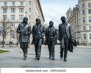Liverpool (UK) - May 2018: Bronze statue of The Beatles sculpted by Andrew Edwards at Pier Head in Liverpool