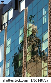 Liverpool / UK - November 29 2019: Reflection of Royal Liver building in Strand street office block windows.