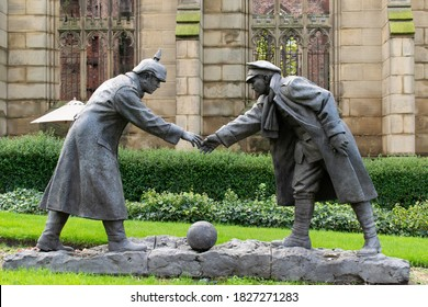 Liverpool, UK. October 4, 2020. Christmas Truce statue with football and handshake in front of the bombed out church