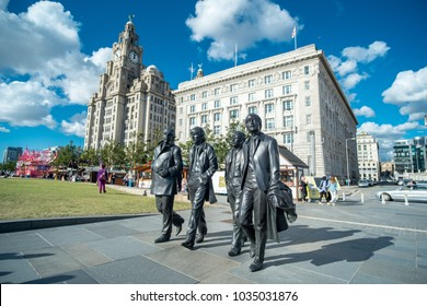 Liverpool, United Kingdom - 20 July 2017: Bronze statue of the Beatles stands on Liverpool's Pier Head waterfront