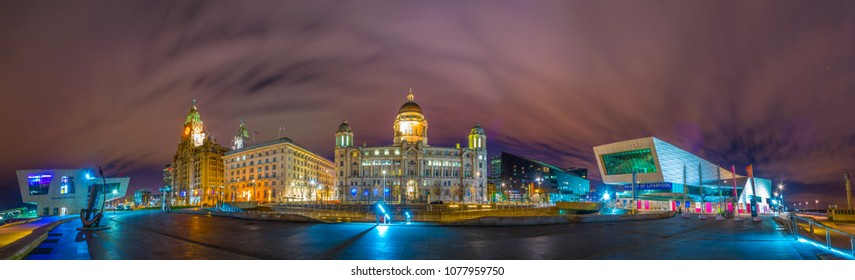 LIVERPOOL, UNITED KINGDOM, APRIL 6, 2017: Night panorama of Three Graces and the museum of Liverpool, England