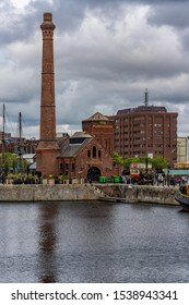 LIVERPOOL, UNITED KINGDOM - AUGUST 11: View of the famous Pump House, an historic industrial building which is now a pub on The Royal Albert Dock on August 11, 2019 in Liverpool