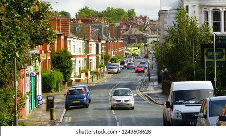 Liverpool / United Kingdom - August 2012: Penny Lane road with parked cars in Liverpool, England.