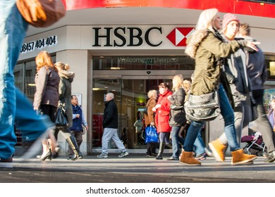 Liverpool, United Kingdom - Dec 9th 2013: People walk past a HSBC bank brand in Liverpool, UK. With headquarters in London, HSBC is one of the largest banking &  financial services organisations.