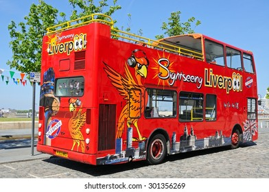 LIVERPOOL, UNITED KINGDOM - JUNE 11, 2015 - Red tour bus by the Ferry Terminal, Liverpool, Merseyside, England, UK, Western Europe, June 11, 2015.