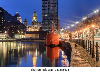 Liverpool waterfront at night. Famous red ship docked at canning dock in Liverpool UK.
