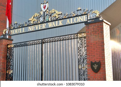 LIVERPOOL,ENGLAND - UK - DEC 7, 2017  : Red bird logo on the gate of Liverpool Football Club at Anfield Stadium in Mercy side, Liverpool UK. You'll never walk alone is slogan of the club.The KOP