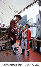 Liverpool,Merseyside/England,UK-August 26 2018 : Two men dressed as pirates in a playful confrontation at Liverpool's Albert Dock on board the sailing ship, Zebu during the Folk On The Dock Festival.