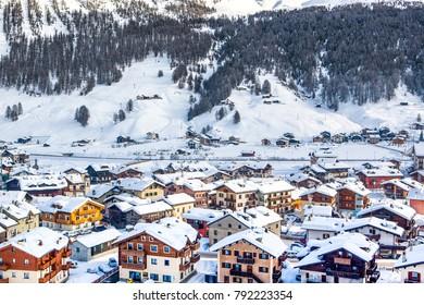 Livigno, Italy - 2 January 2018: Beautiful winter sunny landscape of the Alpine village in Dolomites mountains, Livigno, Italy, 2 January 2018