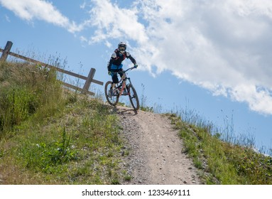 Livigno italy 27th July 2015: descent along the ski slope by bike