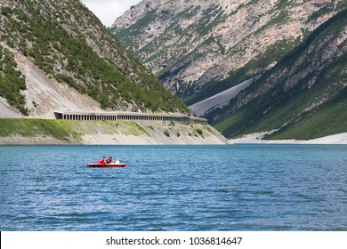 LIVIGNO, ITALY - AUGUST 1: Woman with boy sailing on pedal boat on Lago di Livigno on 1 August 2016 in Livigno, Italy.