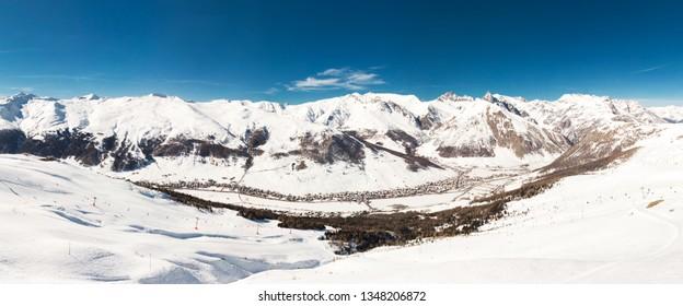 LIVIGNO, ITALY - Feb. 2019 - Skiers skiing in Livigno ski resort, Livigno, Italy, Europe.