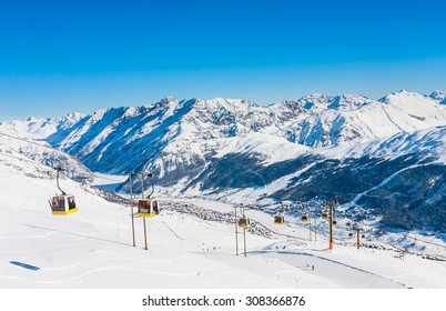 LIVIGNO, ITALY - JANUARY 26, 2015: Gondola cable car and ski slopes in the mountains of winter resort Livigno, Lombardi, January 26, 2015, Italy. Livigno is  developing ski resort in northern Italy