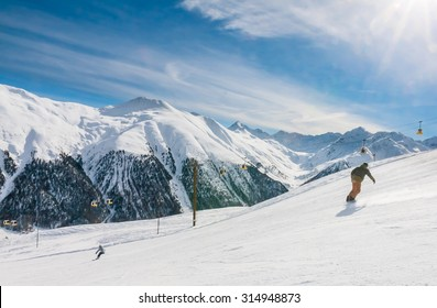 LIVIGNO, ITALY - JANUARY 28, 2015: Skiers on the slope of  Ski resort Livigno, Lombardi, January 28, 2015, Italy. Livigno is  developing ski resort in northern Italy