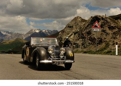 LIVIGNO, ITALY - JUNE 13: A brown Triumph Roadster 1800 takes part to the Summer Marathon classic car race on June 13, 2014 in Livigno. This car was built in 1948