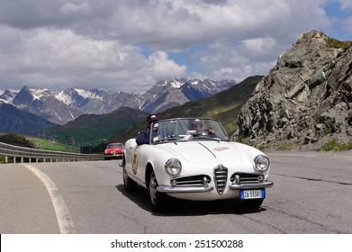 LIVIGNO, ITALY - JUNE 13: A white Alfa Romeo Giulietta spider and a red Alfa Romeo 1900 Super Sprint take part to the Summer Marathon classic car race on June 13, 2014 in Livigno.Both were built in 56