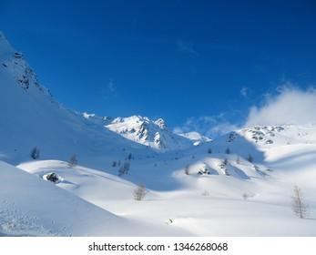 """LIVIGNO, ITALY - March 8 2019: The Landscape near the town of """"Livigno"""" (Italian Alps), on a winter day."""