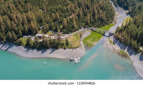 Livigno, Sondrio, Italy. July 28, 2018. Drone aerial view of the Lake Livigno an the Lodge Alpisella. Italian Alps. Italy
