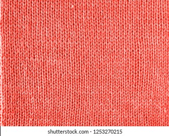 Living Coral color knitted Jersey as a textile background. Knitted Living Coral texture. Color of the year 2019 concept.