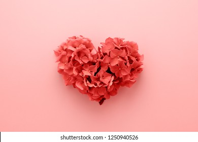 Living Coral color of the Year 2019. Heart shape made of flowers. Valentine's day. Color palette. Love fashion.