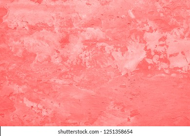 Living Coral color of the Year 2019 Patchy texture of  rough concrete wall or abstract plaster background.