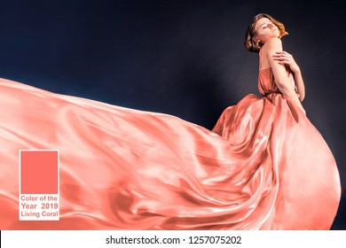 Living Coral - Color of the Year 2019. young woman in a long flowing dress