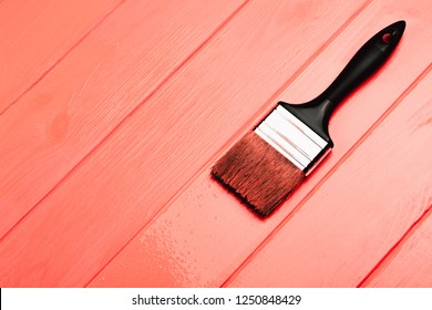 Living Coral fresh painted wooden board. Renovation concept. Top view. Color of the year 2019. Renovation concept.