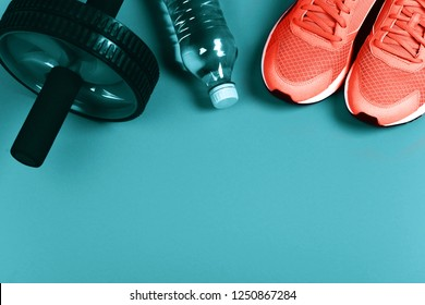 Living Coral sneakers on blue background. Fitness background. Color of the year 2019. Main trend concept.