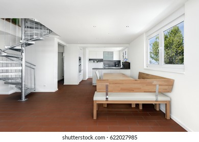 Living dining room with kitchen and stairs