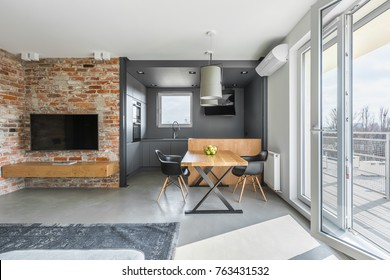 Living and dining space in contemporary styled flat