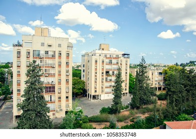 Living district Givat Nof of multistory residential houses among the green trees are located in Ness Ziona, Israel.
