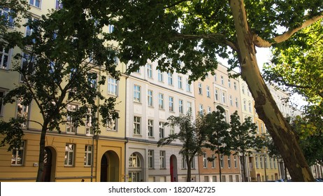 Living environment with a street tree in front of the refurbished old building facades in the green streets of the district Prenzlauer Berg in Berlin, Germany - Shutterstock ID 1820742725