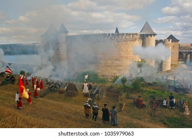 The living history festival in Khotyn fortress (Chernivtsi region, Ukraine). Re-enactors stand in cannon smoke trying to conquer the castle. Historical reenactment of medieval battle of Khotyn (1621)