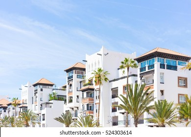Living house with appartments and balconies in arabian style with sky background. Selective focus.